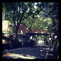 Photo taken at 桜坂 by Tak N. on 8/5/2012