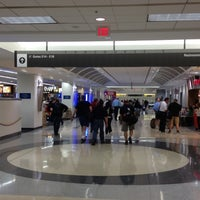 Photo taken at Concourse E by Fidel F. on 3/18/2012