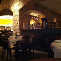 Photo taken at Romano's Macaroni Grill by Christopher S. on 6/30/2012