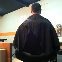 Photo taken at Top of the Line Barbershop by Ramon C. on 8/14/2012