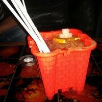 Photo taken at Bad Juju Tiki Bar by Sarah W. on 7/27/2012