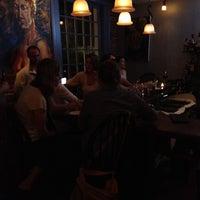 Photo taken at Four Restaurant by Nick V. on 4/17/2012
