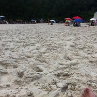 Photo taken at Praia da Ferrugem by Felippe C. on 2/6/2012
