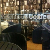 Photo taken at Angel-in-us Coffee by Den F. on 5/5/2012