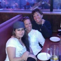 Photo taken at Fat Willy's Family Sports Grill by Neda R. on 4/3/2012