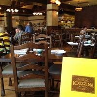 Photo taken at Kouzzina by Nancy W. on 7/21/2012