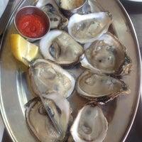 Photo taken at Biggie's Restaurant, Raw Bar, and Tavern by Jamie K. on 5/6/2012