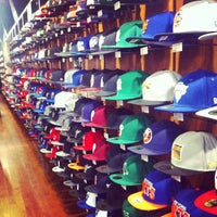 Photo taken at New Era Flagship Store: New York by Suraj S. on 3/17/2012