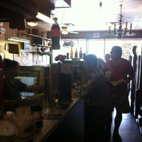 Photo taken at Hungry Hank's Deli by Richard R. Harding on 8/30/2012