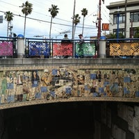 Photo taken at 16th St. Mission BART Station by Christina H. on 5/21/2012