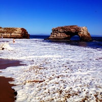 Photo taken at Natural Bridges State Beach by Herbert Y. on 6/15/2012