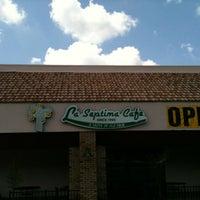 Photo taken at La Septima Cafe by Derek R. on 4/1/2012
