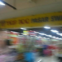 Photo taken at Top 100 Supermarket by Tino T. on 3/12/2012