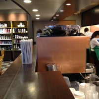 Photo taken at Starbucks by masahide a. on 6/28/2012