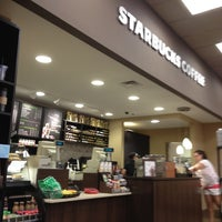 Photo taken at Starbucks by Denisse A. on 6/13/2012