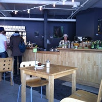 Photo taken at Communitea Cafe by Kate H. on 3/4/2012