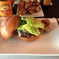 Photo taken at Umami Burger by Lora L. on 2/20/2012