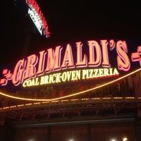 Photo taken at Grimaldi's Coal Brick-Oven Pizza by Naushad I. on 7/8/2012