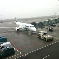 Photo taken at Gate 28 by Dmitry S. on 3/10/2012