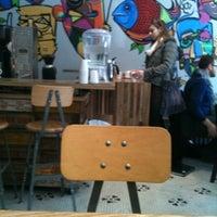 Photo taken at Dollop Coffee & Tea Co. by Carolyn B. on 4/27/2012