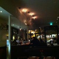 Photo taken at Canela Bistro & Wine Bar by Adriano A. on 6/24/2012
