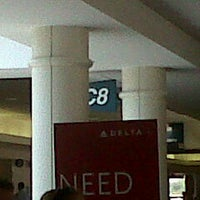 Photo taken at Gate C8 by Sidney F. on 5/26/2012