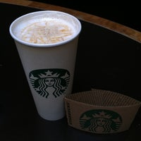 Photo taken at Starbucks by Christina H. on 3/19/2012