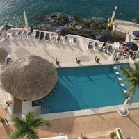 Photo taken at Coral Princess Golf & Dive Resort by Jill Y. on 3/14/2012