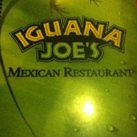 Photo taken at Iguana Joe's by Xavier G. on 2/12/2012