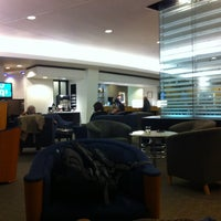 Photo taken at Delta Sky Club by Brad L. on 2/25/2012
