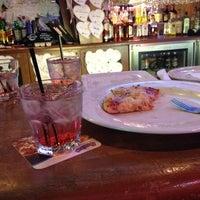 Photo taken at Boston's Restaurant & Sports Bar by Kirstin R. on 2/22/2012