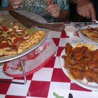 Photo taken at Pullanos Pizza & Wings by Tom K. on 9/5/2012