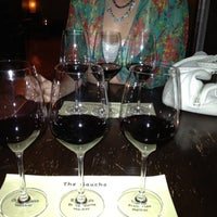 Photo taken at Uncorked Tasting Room & Wine Bar by Megan H. on 8/8/2012