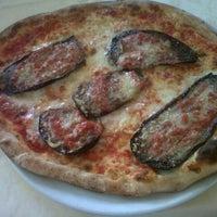 Photo taken at Pizzeria Iris by Vi S. on 7/17/2012