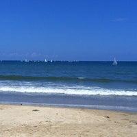 Photo taken at Tanjung Aru 1st Beach by Junior Y. on 5/27/2012