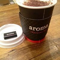 Photo taken at Aroma Espresso Bar by Ashley L. on 5/25/2012