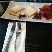 Photo taken at Mignon Wine & Cheese Bar by Nina S. on 4/29/2012