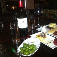 Photo taken at Cava Wine Bar by Jessica V. on 4/22/2012