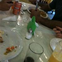 Photo taken at Barra do Sahy by Tati Maia M. on 6/17/2012