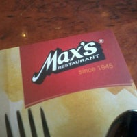 Photo taken at Max's Restaurant by roger E. on 7/23/2012