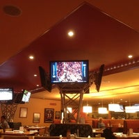 Photo taken at Sporting News Grill by Lance M. on 5/8/2012