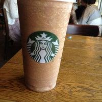 Photo taken at Starbucks by Julie G. on 5/6/2012