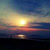 Photo taken at Tanjung Aru 1st Beach by Tuns M. on 8/4/2012