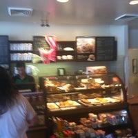 Photo taken at Starbucks by Sam V. on 8/12/2012