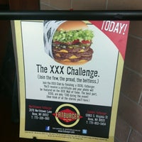 Photo taken at Fatburger by Jenna A. on 7/9/2012
