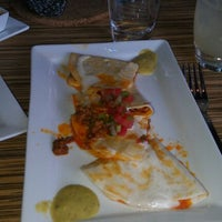 Photo taken at BARRIO Tacos & Tequila by Sharon U. on 5/15/2012