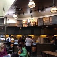 Photo taken at Starbucks by Adrian M. on 4/19/2012