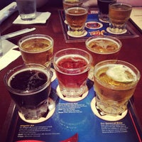 Photo taken at Hops Restaurant Bar & Brewery by Charlie H. on 7/1/2012