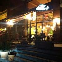 Photo taken at Çikolata Cafe by Okan T. on 3/19/2012