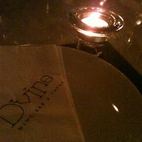 Photo taken at D' vine Wine Bar & Tapas by Phakphum Z. on 3/2/2012